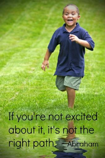 Happy mixed race boy running through green grass